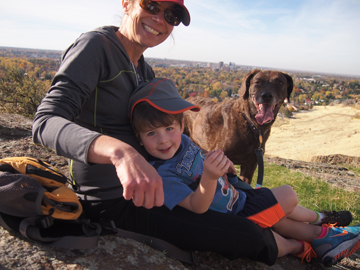 Aimee Shipman, her son, Nathan, and their dog, Ancho, take a break from a hike in Castle Rock Reserve in Boise's east end.