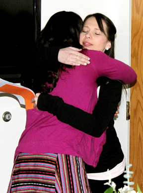 Falen LeBlanc gets a hug from Kailamai Hansen, one of the former youth in foster care Falen helped mentor.