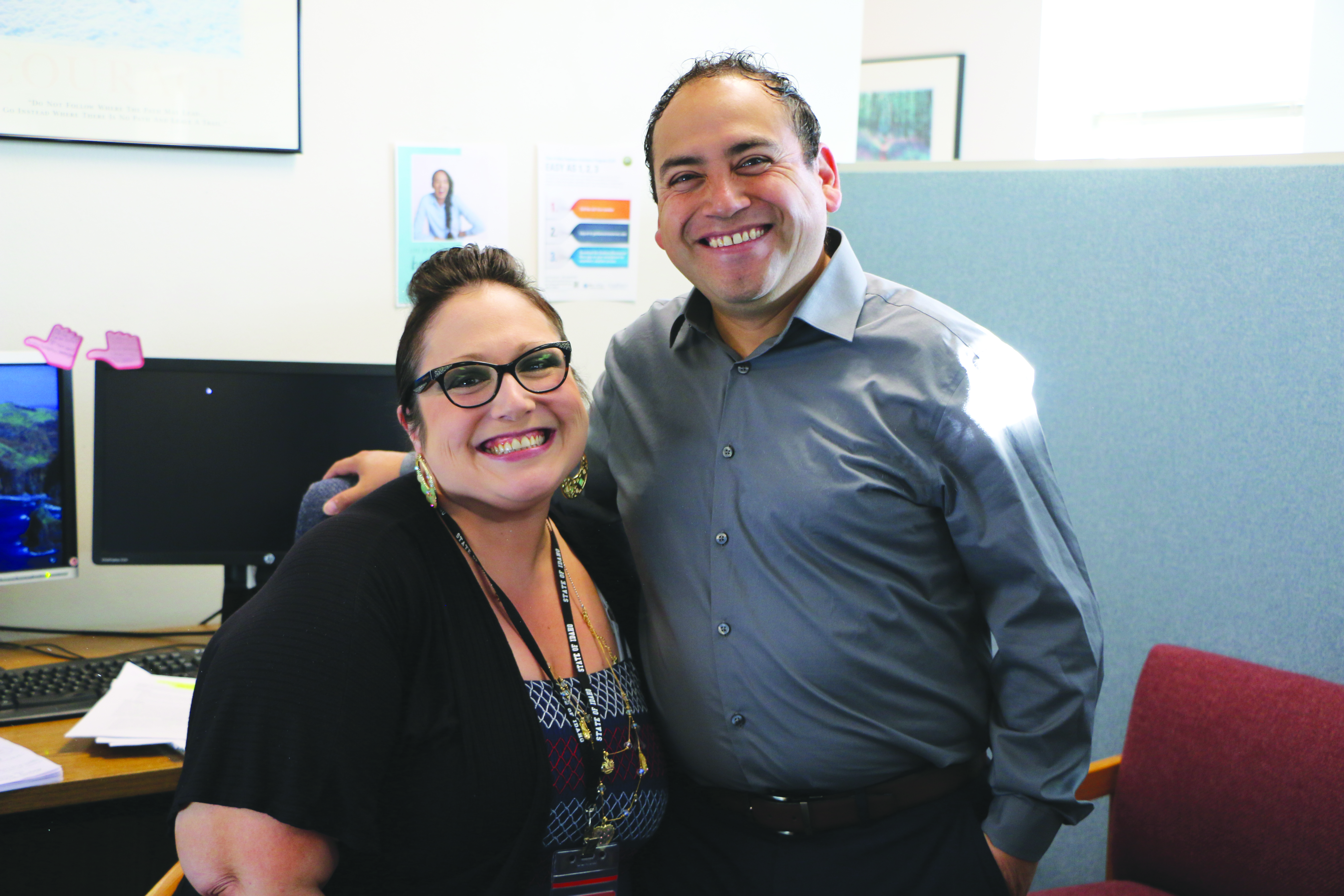 Carlos Ramos, pyschosocial rehabilitation specialist, and Christine Poff, client services technician, pause for a photo before starting their work day in Family and Community Services. See page 3 to read about a day in the life of Carlos.