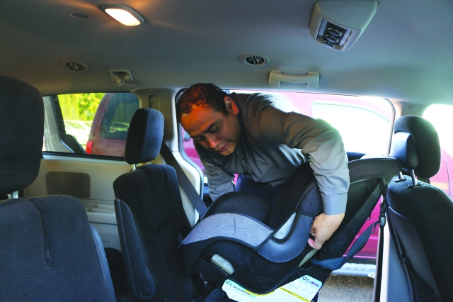 Carlos Ramos secures a car seat in record time.
