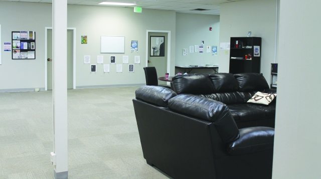 One of the two large main areas at the 7,000 square-foot Pathways Community Crisis Center of Southwest Idaho in Boise. Each of the two sides, one for men and one for women, includes nine beds in a common central area that also houses TVs and other recreational items. Each side also has one additional bed located in a quiet room, for a total of 20 beds available. Clinician and nurse offices surround the central areas. Between the two sides is a kitchen with areas for clients and staff, as well as a room packed with laundry facilities, clothing and a variety of other donations.