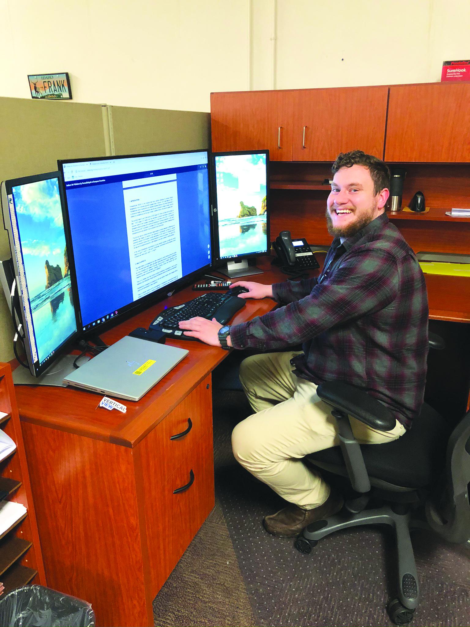 Photo of Dan Asbury at his desk