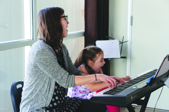 Kate Schnieder, board-certified music therapist at The Lotus Tree Sensory Integration Center in Boise, guides her piano duet with Client N as they work up to the grand finale of their piano duet.